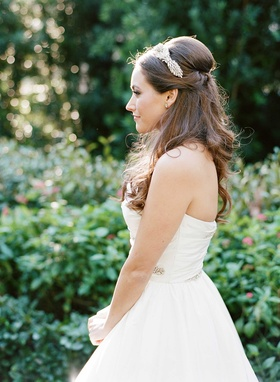 Bride profile silhouette in strapless Reem Acra wedding dress hair down Jenny Packham hair accessory