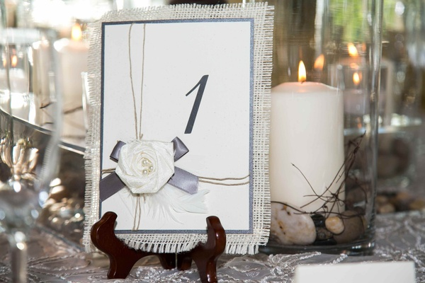 Easel table number stand with fabric rose and ribbon