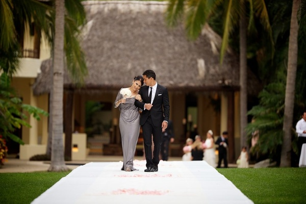Celebrity groom walking down aisle with his mom