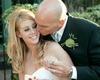 groom kisses his bride's cheek