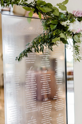 wedding seating chart at cocktail hour mirror reflective with white etching alphabetical find seat
