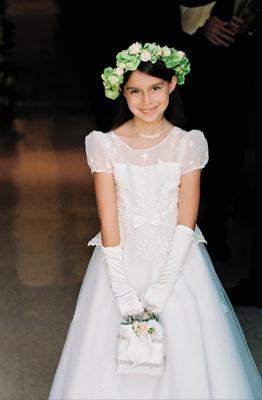 Flower girl in short sleeved dress with white finger gloves