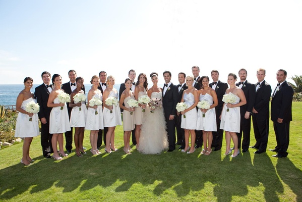 Bridesmaids and groomsmen on oceanfront cliff