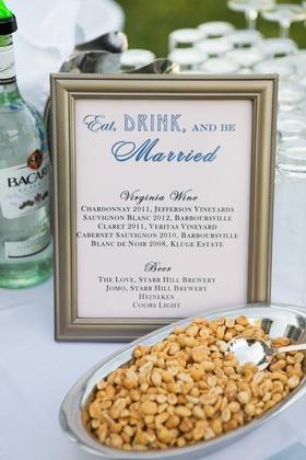 Roasted peanuts at wedding bar with framed menu