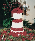 Rose petals on three layer wedding cake