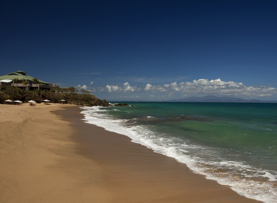 Sandy beach and turquoise water at W Retreat & Spa, Vieques Island.