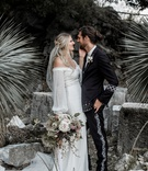 ashley castanos daughters of simone designer in boho chic off shoulder wedding dress with groom