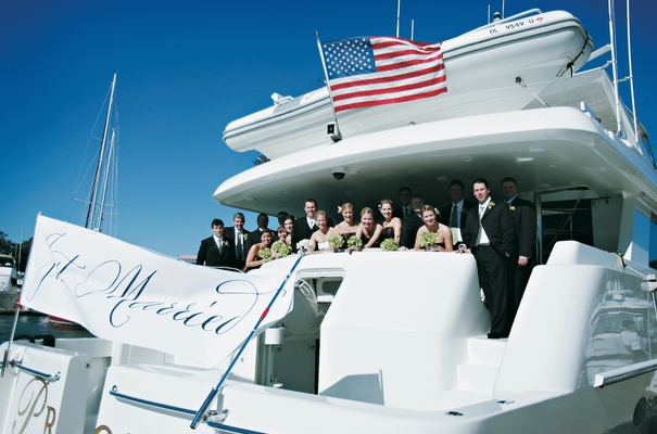 Charter ferry with American flag and Just Married