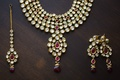 Indian wedding bridal jewelry gold earrings, headpiece, and necklace