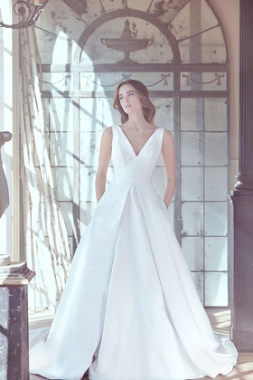 Sareh Nouri Spring 2019 collection v neck jacquard a line gown with pockets and cathedral train