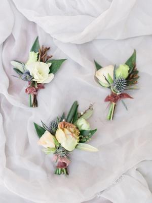 wedding boutonniere blue thistle white flower dusty rose ribbon greenery organic flower ideas