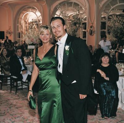 Green bridesmaid dress and long-tail groomsman tux