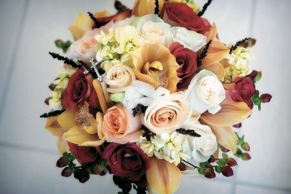 Wedding bouquet with rose, orchid, and fern varieties