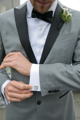 Wedding attire hunter pence baseball player grey tuxedo black lapel silver cuff links boutonniere