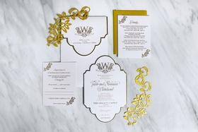 white gold wedding invitation on marble table gold laser cut details die cut invite monogram