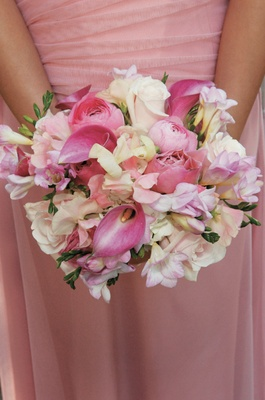 bridesmaid in pink dress holds pink and white flowers