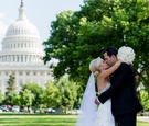 Bride and groom kiss with view of United States Capitol