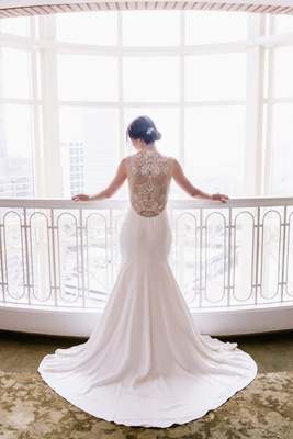 bride in lela rose wedding dress, detailed illusion back hair in bun
