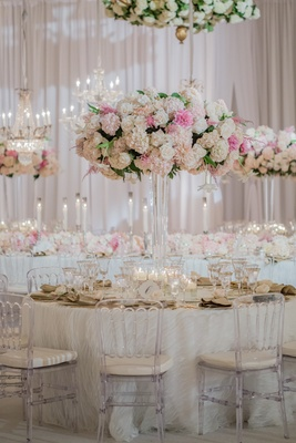 Wedding reception at a Montage Laguna Beach ballrooms with white, pink roses, hydrangeas, dahlias