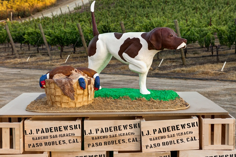 Dead bird and spotted dog on wine boxes