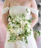 cream colored flowers green bouquet roses vines catholic wedding california