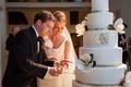 Bride and groom cut magnolia and monogram cake