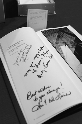 Black and white image of signed coffee table guest book