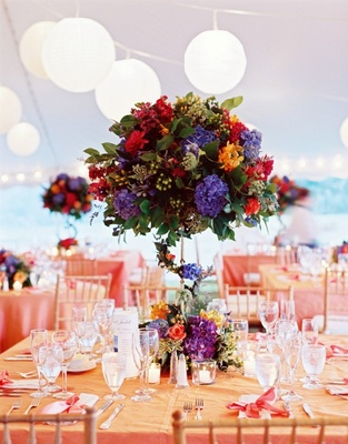 Colorful tent wedding flower centerpiece at reception