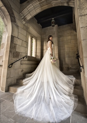 hayley paige wedding dress a-line gown with long tulle train cascading over steps