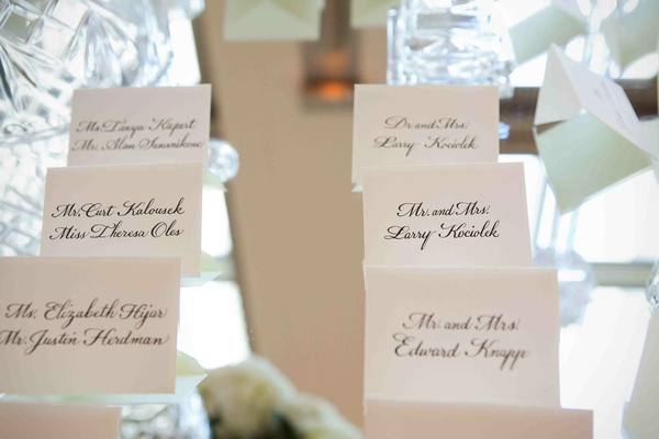Seating card display on mirrored tabletop