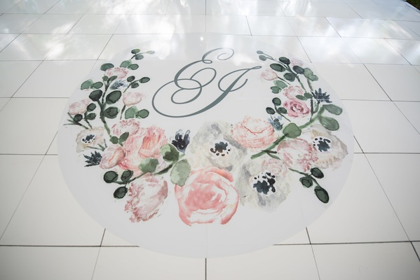 custom wedding dance floor with painted florals and initials