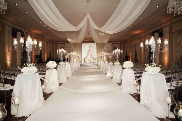 Clear candelabra on pedestals and chandeliers