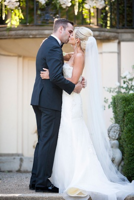 a bride and groom share their first kiss as a married couple at an estate in northern california