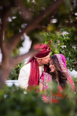 Bride in lehenga and groom in sherwani for vibrant Hindu wedding ceremony
