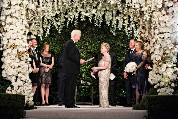 wedding ceremony vow renewal white flowers orchids roses chuppah greenery chandelier vow renewal