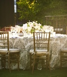 Alfresco reception table with gilt chairs and linens