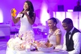 maid of honor with white katie may dress giving toast in room with purple uplighting