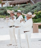 Mariachi band in white outfits at a beach wedding in Playa del Carmen, Mexico