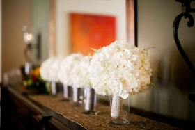 Bridesmaid and bridal nosegays in cylindrical vases