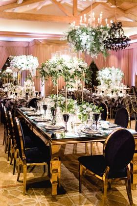 Charlise Castro and George Springer wedding reception table black chair velvet gold table flowers