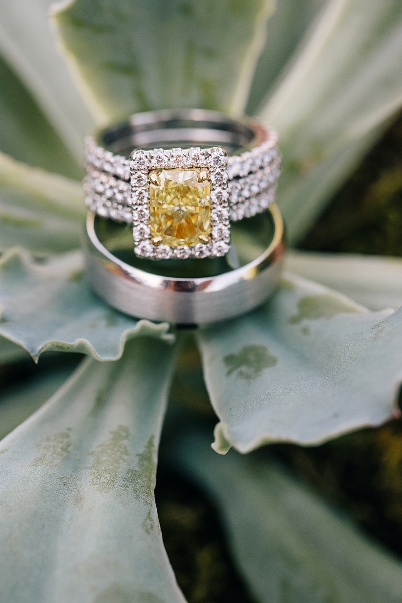 Three-row ring with yellow diamond and halo