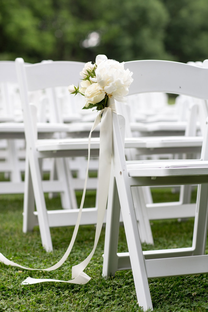 Wedding ceremony chair - White Ceremony Chair With Ribbon And Flower Details Peony Grass Lawn Outdoor Ceremony