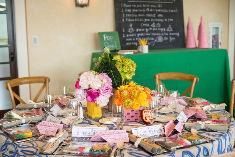 pink peonies in pencil centerpiece, yellow flowers in pink eraser centerpiece, green in ruler vase