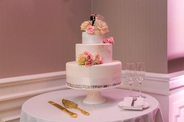 three tier wedding cake with styrofoam layers and fresh flowers