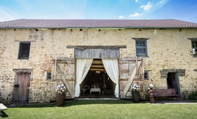 Gehlen Barn wedding venue in Iowa with flowers and drapery