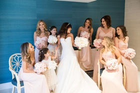 Bride in oscar de la renta wedding dress pink bridesmaid dresses and little maid of honor twins