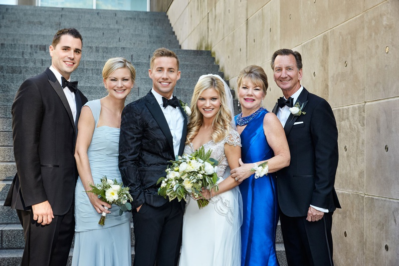 wedding portrait chicago mother of bride royal blue evening gown father of bride tuxedo bridesmaid