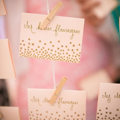 escort cards with gold calligraphy and gold dots DIY confetti handwritten
