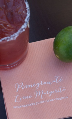 Wedding reception cocktail hour signature drink calligraphy on cocktail beverage napkin pomegranate