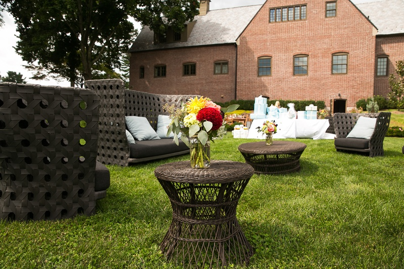 Brown patio furniture on grass lawn at outdoor bridal shower